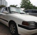 Cần bán Mazda 323 1.6 MT năm 1996, màu trắng giá cạnh tranh giá 60 triệu tại Hà Nội