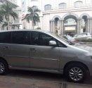 Cần bán Toyota Innova 2.0E 2014, màu bạc, số sàn giá 568 triệu tại Tp.HCM