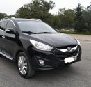 Cần bán lại xe Hyundai Tucson 2.0 AT. Sản xuất năm 2011, màu đen, xe nhập giá 550 triệu tại Hà Nội