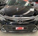 Bán ô tô Toyota Camry 2.0E sản xuất 2015, màu đen, giá tốt giá 920 triệu tại Tp.HCM