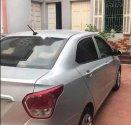 Chính chủ bán xe Hyundai Grand i10 năm 2015, màu bạc giá 300 triệu tại Hà Nội