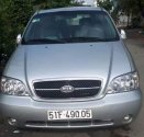 Bán ô tô Kia Carnival đời 2006, màu bạc, nhập khẩu nguyên chiếc giá 250 triệu tại Tp.HCM