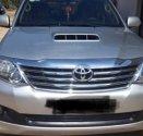 Bán xe Toyota Fortuner 2015, màu bạc số sàn giá cạnh tranh giá 820 triệu tại Đồng Tháp