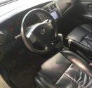 Gia đình bán Nissan Livina đời 2010, màu trắng, nhập khẩu  giá 370 triệu tại Hà Nội
