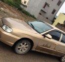 Cần bán lại xe Kia Spectra năm sản xuất 2004, màu vàng giá 105 triệu tại Thái Nguyên
