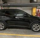 Bán xe Hyundai Santa Fe 2015 màu đen máy dầu, bản đặc biệt 2 cầu có cửa sổ trời giá 921 triệu tại Tp.HCM