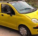 Bán Daewoo Matiz sản xuất năm 2002, màu vàng, xe gia đình giá 53 triệu tại Tp.HCM