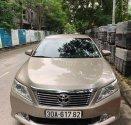 Cần bán gấp Toyota Camry năm 2013, màu vàng giá 665 triệu tại Hà Nội