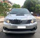 Bán Toyota Fortuner MT sản xuất 2014, màu bạc xe gia đình  giá 705 triệu tại Tp.HCM