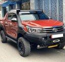 Nhà cần ra đi em Toyota Hilux 2017 AT, máy dầu, màu cam độc nhất giá 690 triệu tại Tp.HCM