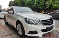 Cần bán lại xe Mercedes E200 sản xuất 2016, màu trắng giá 1 tỷ 500 tr tại Hà Nội