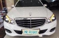 Bán Mercedes E200 đời 2014, màu trắng giá 1 tỷ 390 tr tại Hà Nội