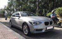 Cần bán xe BMW 1 Series 116i đời 2014, màu bạc giá 950 triệu tại Tp.HCM
