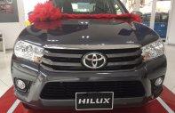 Cần bán xe Toyota Hilux 2.4E AT tự động đời mới, nhập khẩu Thái Lan, hỗ trợ 85% giá trị xe giá 673 triệu tại Tp.HCM