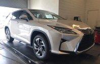 Cần bán xe Lexus RX 350L đời 2018, màu vàng cát, nội thất kem xe nhập Mỹ giá 4 tỷ 890 tr tại Hà Nội