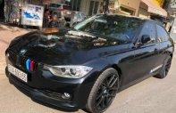Cần bán BMW 3 Series 320i đời 2014, màu đen, nhập khẩu nguyên chiếc giá 1 tỷ 16 tr tại Tp.HCM