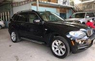 Cần bán xe BMW X5 4.8i sản xuất 2006, màu đen, xe nhập còn mới giá cạnh tranh giá 686 triệu tại Tp.HCM