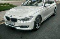 Bán ô tô BMW 3 Series 320i 2014, màu trắng, xe nhập giá 896 triệu tại Tp.HCM