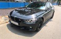Cần bán BMW 3 Series 320i sản xuất 2012, màu đen, nhập khẩu, 816 triệu giá 816 triệu tại Tp.HCM