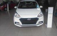 Cần bán Hyundai Grand i10 1.2L MT đời 2018, màu trắng, giá tốt xe giao ngay giá 382 triệu tại Hà Nội