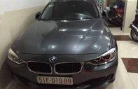 Cần bán lại xe BMW 3 Series 320i năm 2014, màu bạc giá 1 tỷ 50 tr tại Tp.HCM