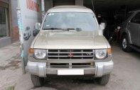Cần bán lại xe Mitsubishi Pajero đời 2006, màu ghi vàng giá 260 triệu tại Tp.HCM