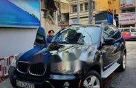 Cần bán xe BMW X5 3.0 Si 2007, màu đen, xe nhập, giá 660tr giá 660 triệu tại Tp.HCM