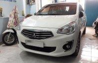 Cần bán Mitsubishi Attrage 1.2 MT màu trắng, đăng ký 4/2017 giá 415 triệu tại Tp.HCM