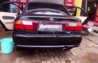 Bán Mazda 323 1.6 MT đời 1998, màu đen, nhập khẩu Nhật Bản giá 97 triệu tại TT - Huế