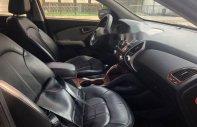 Cần bán xe Hyundai Tucson 4WD 2.0AT năm sản xuất 2011, màu đen, nhập khẩu hàn quốc, 580 triệu giá 580 triệu tại Bình Dương