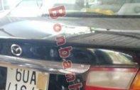 Bán Mazda 323 1.6 MT đời 2000, màu đen, giá chỉ 98 triệu giá 98 triệu tại Đồng Nai