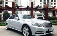 Chính chủ bán Mercedes E250 đời 2012, màu bạc giá 960 triệu tại Hà Nội