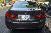 Cần bán xe BMW 3 Series 320I sản xuất năm 2013, màu nâu, nhập khẩu nguyên chiếc, giá tốt giá 850 triệu tại Tp.HCM