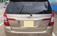 Bán ô tô Toyota Innova E đời 2014, màu vàng số sàn giá 565 triệu tại Tp.HCM