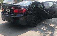Cần bán gấp BMW 3 Series 320i năm sản xuất 2013, màu đen, 865 triệu giá 865 triệu tại Tp.HCM