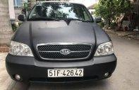 Bán xe Kia Carnival đời 2009, màu đen chính chủ, giá tốt giá 275 triệu tại Tp.HCM