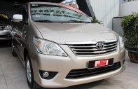 Bán xe Toyota Innova E đời 2013, màu nâu vàng, giá tốt giá 570 triệu tại Tp.HCM