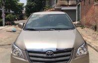 Bán Toyota Innova 2.0E màu vàng cát số sàn, sản xuất cuối 2014 mẫu mới biển Sài Gòn giá 586 triệu tại Tp.HCM