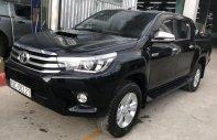 Cần bán xe Toyota Hilux năm sản xuất 2015, màu đen, nhập khẩu nguyên chiếc giá cạnh tranh giá 708 triệu tại Tp.HCM