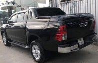 Bán ô tô Toyota Hilux XLS AT sản xuất năm 2016, màu đen giá 708 triệu tại Tp.HCM