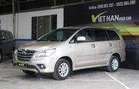 Cần bán xe Toyota Innova E 2.0MT sản xuất 2014, màu vàng giá 586 triệu tại Tp.HCM