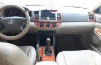 Bán Toyota Camry sản xuất năm 2004, màu đen  giá 350 triệu tại Tp.HCM