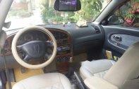 Cần bán xe Kia Spectra 1.6 2005, màu bạc chính chủ, giá tốt giá 115 triệu tại Hà Nội