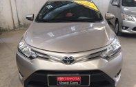 Cần bán xe Toyota Vios E số sàn đời 2015, màu nâu vàng giá 500 triệu tại Tp.HCM
