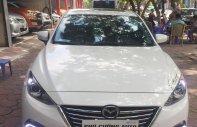Cần bán xe Mazda 3 1.5AT Sedan, năm sản xuất 2015, màu trắng, 609 triệu giá 609 triệu tại Hà Nội