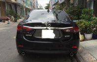 Cần bán lại xe Mazda 6 2.0AT đời 2017, màu đen còn mới giá 789 triệu tại Tp.HCM