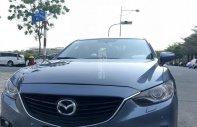 Tôi cần bán xe Madza 6 2.5AT, màu xanh 2014 giá 740 triệu tại Tp.HCM