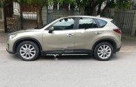 Cần bán xe Mazda CX 5 đời 2014, màu vàng số tự động giá cạnh tranh giá 712 triệu tại Hà Nội