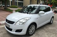 Cần bán gấp Suzuki Swift 1.4 AT năm sản xuất 2014, màu trắng giá 440 triệu tại Hà Nội