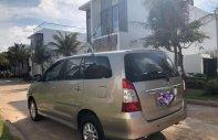 Bán ô tô Toyota Innova 2.0E năm sản xuất 2014, màu vàng chính chủ, giá tốt giá 570 triệu tại BR-Vũng Tàu